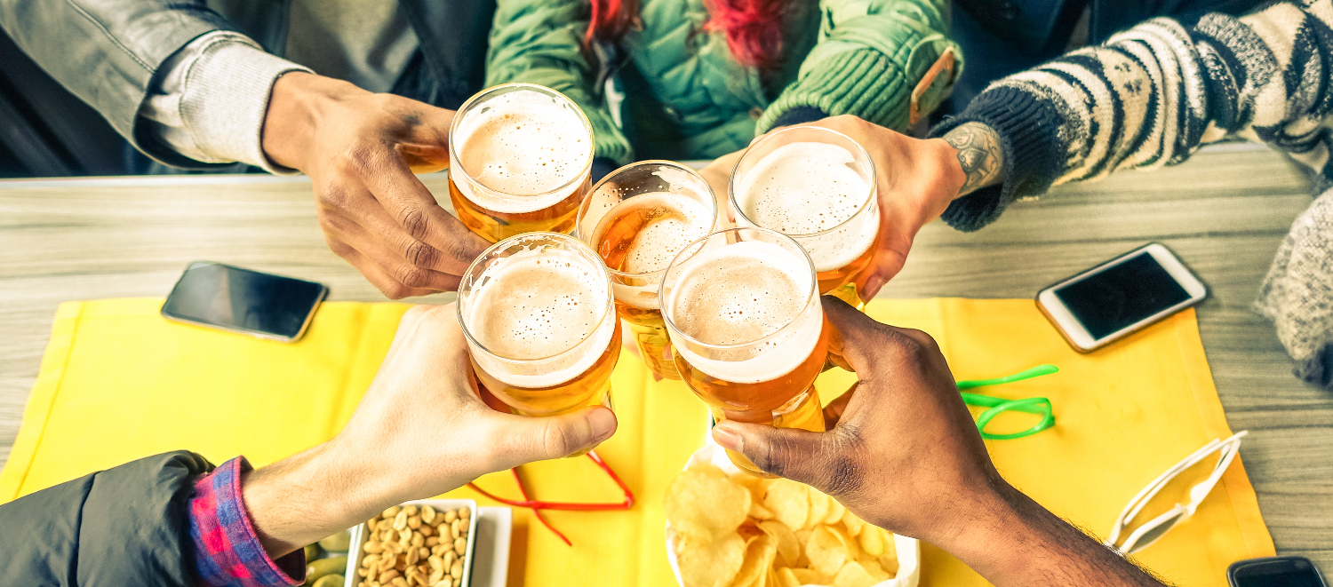 Group of friends cheers with beer